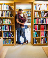 Bookshelves Library Romantic Couple Embracing By Bookshelves In Library Royalty Free