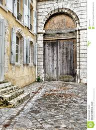 porte cochere carriage entrance on old french house stock images