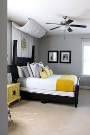 guest bedroom decor with fan lighting and wall art and fabric and