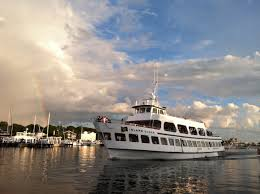 a rainbow over falmouth harbor welcomes the island queen ferry
