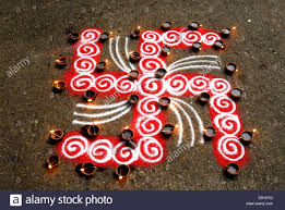 Swastik Decoration Pictures Rangoli Floor Design With Swastik And Lighted Clay Lamps During