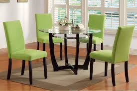dining room furniture glass table with green chair and rounded