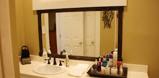 framing bathroom mirror with molding how to add a wood frame to a bathroom mirror today s homeowner