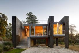 a house between freshwater wetlands and a tidal estuary design milk