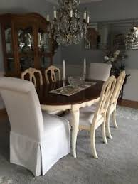ethan allen french country dining room with lighted china cabinet