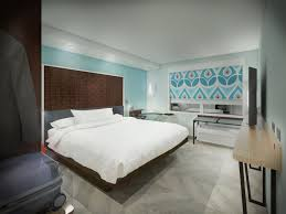 hilton launches new budget hotel chain aimed at young guests cbs