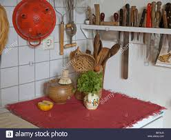 edge in a kitchen with cookware and many different kitchen knives