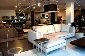 modern home interior floor lamps behind sectional sofas