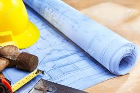 blueprint of house design on wooden desk wth working tools stock
