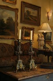 love the oil paintings and antique couch