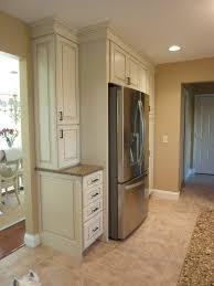 kraftmaid offwhite cabinets with a glaze build in the