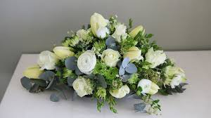 how to make a casket spray white flower funeral spray hardys flowers