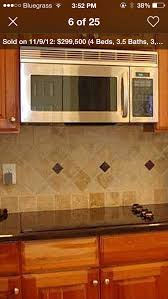 kitchen backsplash ideas with oak cabinets travertine tile with uba tuba granite and oak cabinets kitchen