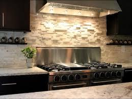 stunning cobblestone backsplash with lighting above stove also