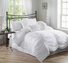 White Bedding Decorating Ideas Bedroom White Bedspread With Brown Wooden Floor And Small Glass