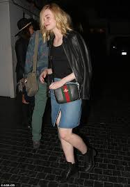 elle fanning appears exhausted after chateau marmont night out