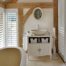 pull out baskets for bathroom cabinets 7 country bathroom cabinets ideal home