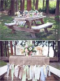 picnic table benches at wedding with ribbon table runner ties