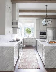 Contemporary White And Grey Kitchen Features Gray Wash Wood - Contemporary white kitchen cabinets