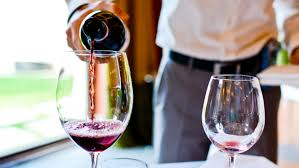 glass of wine why natural bottles deserve a place on white tablecloths