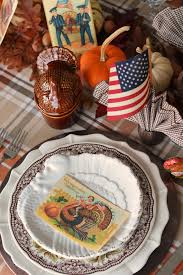 at the table thanksgiving greetings and flags for an american