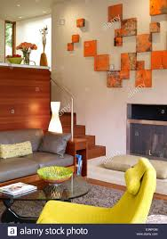 split level living room with orange canvas art display in odyssey