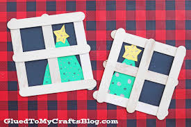popsicle stick christmas tree in window kid craft glued to my
