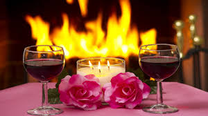 massa two pink roses lamp lit candles two glasses of red wine a