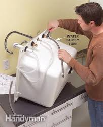how to install a laundry sink convert an unfinished laundry area into a laundry room family handyman