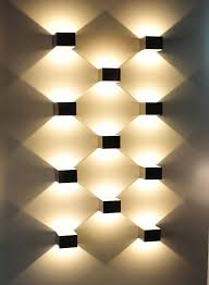 Pattern Wall Lights | logs in is a led wall light with a minimalist and pure design it is