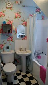 lavish very small bathroom design idea with blue wallpaper with