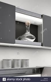 kitchen cabinet sliding doors decanter in cupboard with sliding doors in modern kitchen