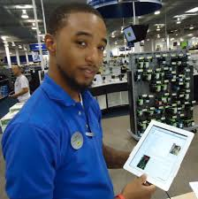 Apple Retail Jobs File Salesperson At Best Buy Demonstrating Apple Ipad Jpg