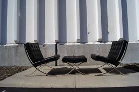 pair of barcelona chairs with ottoman by mies van der rohe for