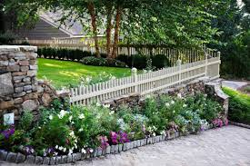 backyard with picket fences and small shrubs different ideas of