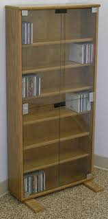 Cd Storage Cabinet With Glass Doors Dvd Cd Bookcase With Glass Doors 27 72 High Oak Maple Usa Made