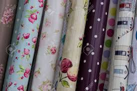 rolls of oilcloth designs in a home interiors shop stock photo