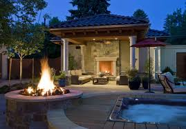 outdoor lighting for pergola with natural fireplace and round fire