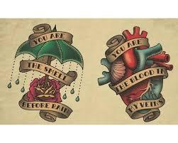 and rose with umbrella tattoo design