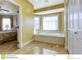 bathroom with shiny tile floor in master bedroom stock photo