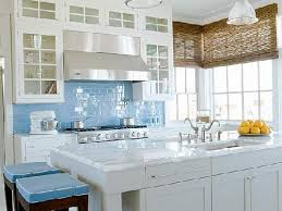 colorful kitchen backsplashes the sky blue backsplash and fabric provide a pop of color in this