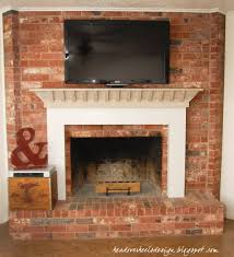 photos hgtv painted brick fireplace with rustic wood mantel loversiq