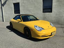 porsche yellow 2003 porsche 911 cabriolet with hardtop low miles