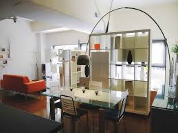 decor tips how to decorate studio apartment with arched floor how to decorate studio apartment with arched floor lamp and dining set also cube bookshelves and studio apartment decorating with sofa plus efficiency