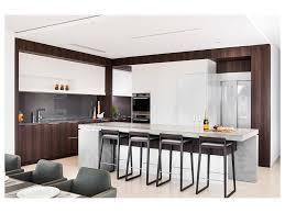 glass wall concrete floor orange kitchen cabinets stainless steel