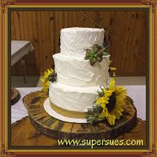 rustic succulent and sunflower wedding cake with textured