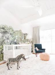 simply beautiful 19 sweet and simple nursery designs simple white nursery space with dramatic wall mural