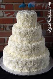 ivory buttercream roses wedding cake with lovebirds cake topper
