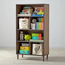 living room dark wood tall bookshelves on laminate wood flooring