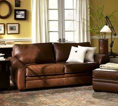 voyageurs47 family tv room brown leather couch with nailhead trim
